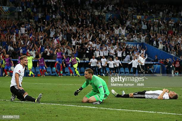 Manuel Neuer and Bastian Schweinsteiger of Germany react after Antoine Griezmann of France scored a goal to make the score 0-2 during the UEFA Euro...