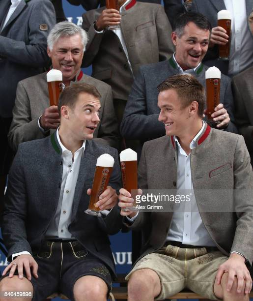 Manuel Neuer and Christian Fruechtl raise their glasses during the FC Bayern Muenchen Paulaner photo shoot in traditional Bavarian lederhosen on...