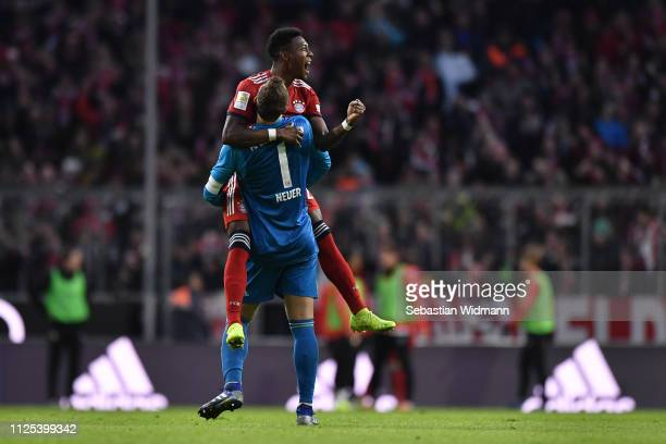 Manuel Neuer and David Alaba of Bayern Munich celebrate their team's third goal during the Bundesliga match between FC Bayern Muenchen and VfB...