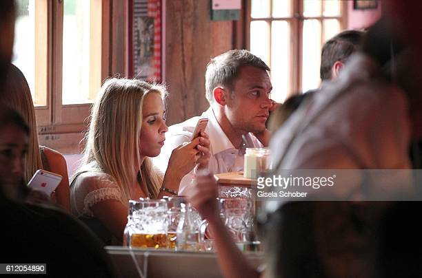 Manuel Neuer and his girlfriend Nina Weiss attend the 'FC Bayern Wies'n' during the Oktoberfest at Kaeferschaenke / Theresienwiese on October 2 2016...