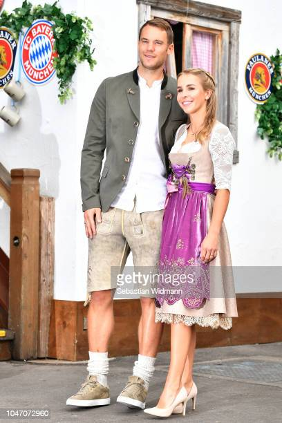 Manuel Neuer and his wife Nina Weiss attend the Oktoberfest beer festival at Kaefer Wiesenschaenke tent at Theresienwiese on October 7, 2018 in...
