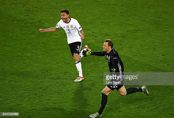 Manuel Neuer and Jonas Hector of Germany celebrate their win through the penalty shootout after Jonas Hector scores to win the game after the UEFA...