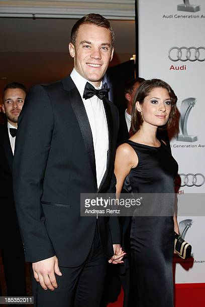 Manuel Neuer and Kathrin Gilch attend Audi Generation Award 2013 on October 19, 2013 in Munich, Germany.