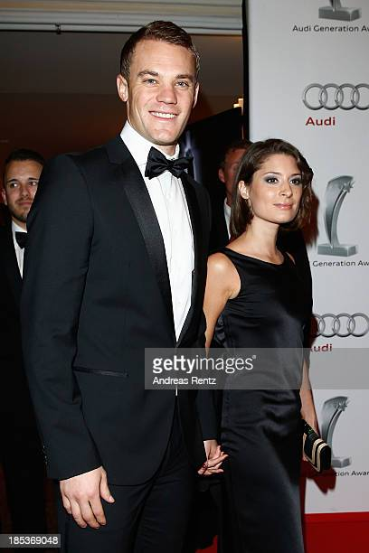 Manuel Neuer and Kathrin Gilch attend the 7th Audi Generation Award 2013 at Hotel Bayerischer Hof on October 19 2013 in Munich Germany