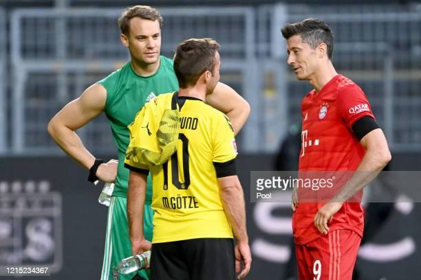 Manuel Neuer and Robert Lewandowski of Bayern Munich speak to Mario Goetze of Borussia Dortmund after the Bundesliga match between Borussia Dortmund...