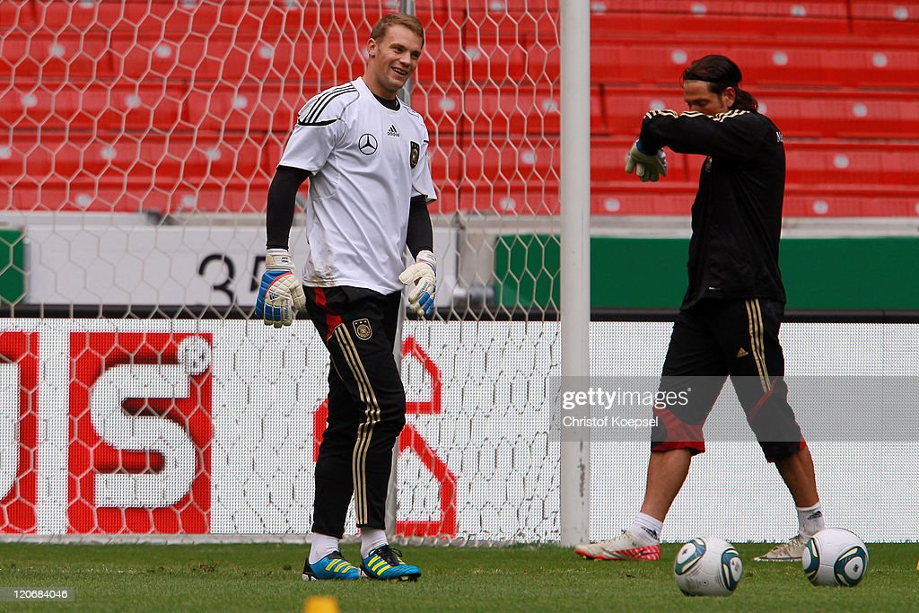 Manuel Neuer and Tim Wiese attend a training session of the German National football team at Mercedes-Benz Arena on August 8, 2011 in Stuttgart, Germany. Germany will play a friendly match against Brazil at Mercedes-Benz Arena on August 10, 2011 in Stuttgart, Germany.