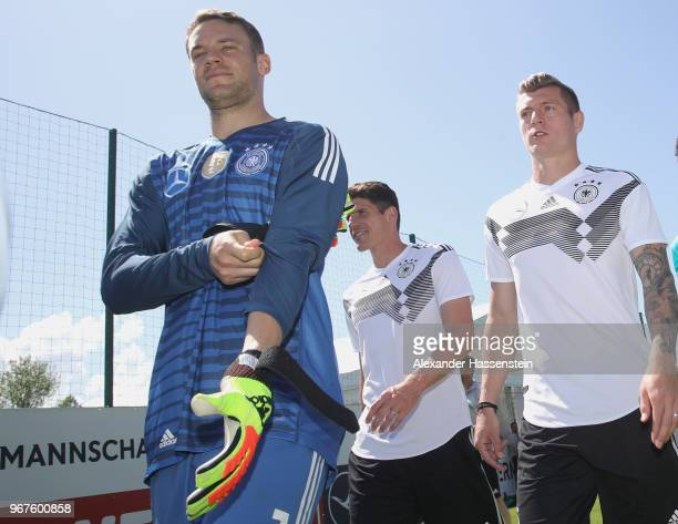 Manuel Neuer arrives with his team mates Mario Gomez and Toni Kroos for a training session of the German national team at Sportanlage Rungg on day...