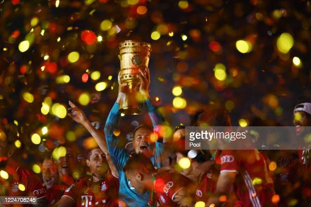 Manuel Neuer, Captain of Bayern Munich lifts the trophy as they celebrate following victory in the DFB Cup final match between Bayer 04 Leverkusen...