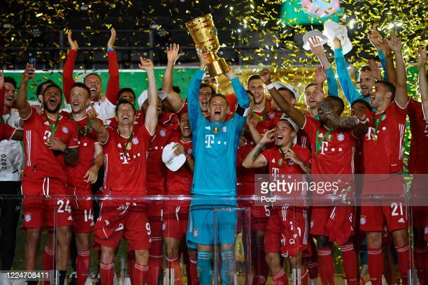 Manuel Neuer, Captain of Bayern Munich lifts the trophy as they celebrate following victory during the DFB Cup final match between Bayer 04...