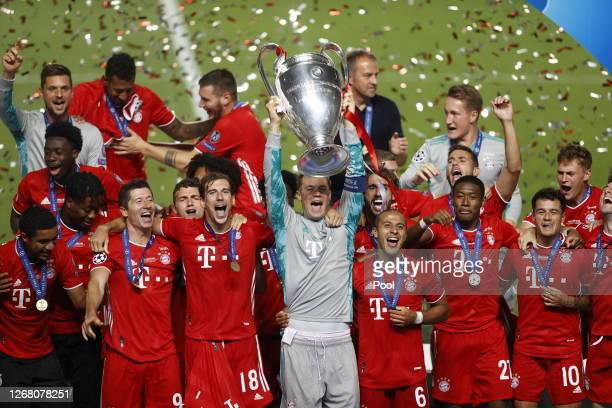Manuel Neuer captain of FC Bayern Munich lifts the UEFA Champions League Trophy following his team's victory in the UEFA Champions League Final...