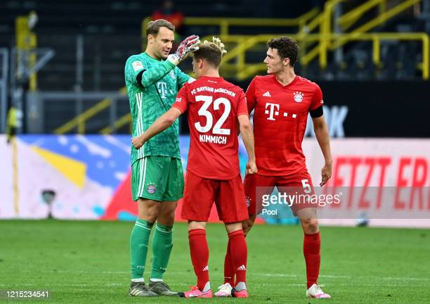 Manuel Neuer celebrates victory with Joshua Kimmich and Benjamin Pavard of Bayern Munich during the Bundesliga match between Borussia Dortmund and FC...