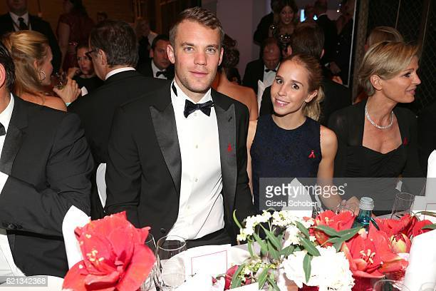 Manuel Neuer goal keeper FC Bayern Munich and his girlfriend Nina Weiss and her mother during the aftershow party of the 23rd Opera Gala at Deutsche...