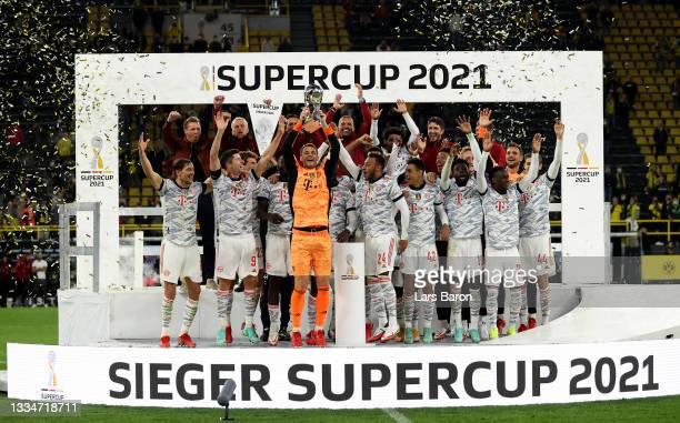 Manuel Neuer, goalkeeper of FC Bayern München lifts the trophy after winning the Supercup 2021 match between FC Bayern München and Borussia Dortmund...