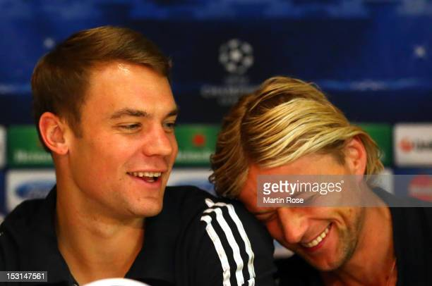 Manuel Neuer goalkeeper of Muenchen jokes with team mate Anatoli Timoschtschuk during a FC Bayern Muenchen press conference ahead of their UEFA...