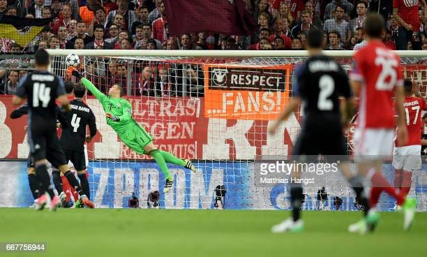 Manuel Neuer goalkeeper of Muenchen makes a save during the UEFA Champions League Quarter Final first leg match between FC Bayern Muenchen and Real...