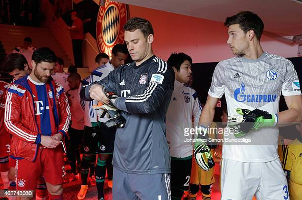 Manuel Neuer goalkeper of Muenchen and Fabian Giefer goalkeper of Schalke put on their gloves ahead of the Bundesliga match between FC Bayern...