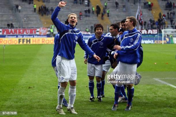 Manuel Neuer Hao Junmin Kevin Kuranyi and Benedikt Hoewedes of Schalke celebrates the 41 victory after the Bundesliga match between Eintracht...