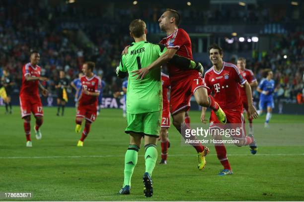 Manuel Neuer keeper of Bayern Muenchen celebrates victory with his team mate Frank Ribery after the UEFA Super Cup between FC Bayern Muenchen and...