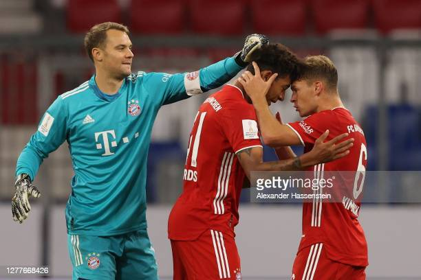 Manuel Neuer keeper of FC Bayern Muenchen celebrates victory with his team mates Christopher Richaird and Joshua Kimmich after winning the Supercup...
