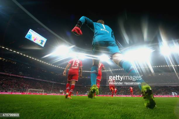 Manuel Neuer, keeper of Muenchen enters the field with his team mates for the Bundesliga match between FC Bayern Muenchen and FC Schalke 04 at...