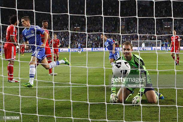 Manuel Neuer, keeper of Muenchen reacts whilst Fernando Torres of Chelsea celebrates scoring the opening goal during the UEFA Super Cup between FC...