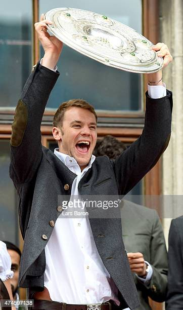 Manuel Neuer lifts the trophy and celebrates winning the Bundesliga at Marienplatz on May 24 2015 in Munich Germany
