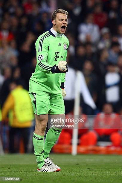 Manuel Neuer of Bayern celebrates after saving a penalty of Cristiano Ronaldo of Real Madrid during the UEFA Champions League semi final second leg...