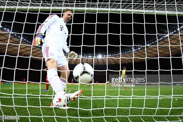 Manuel Neuer of Bayern kicks the ball out of the net after getting the fifth goal during the DFB Cup final match between Borussia Dortmund and FC...