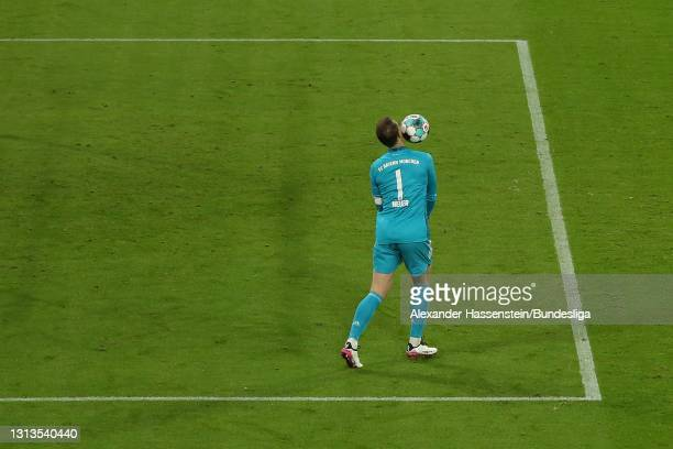 Manuel Neuer of Bayern München plays with the ball during the Bundesliga match between FC Bayern München and Bayer 04 Leverkusen at Allianz Arena on...