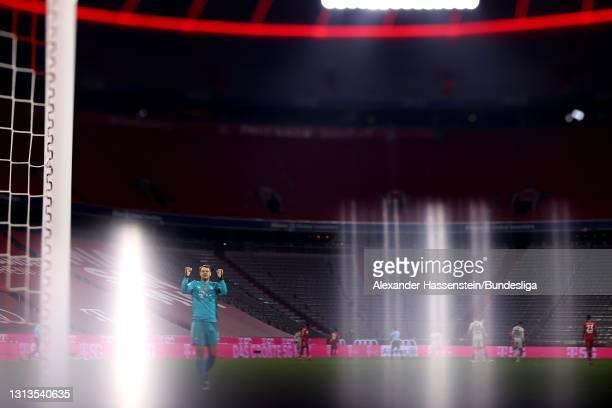 Manuel Neuer of Bayern München reacts after winning the Bundesliga match between FC Bayern München and Bayer 04 Leverkusen at Allianz Arena on April...