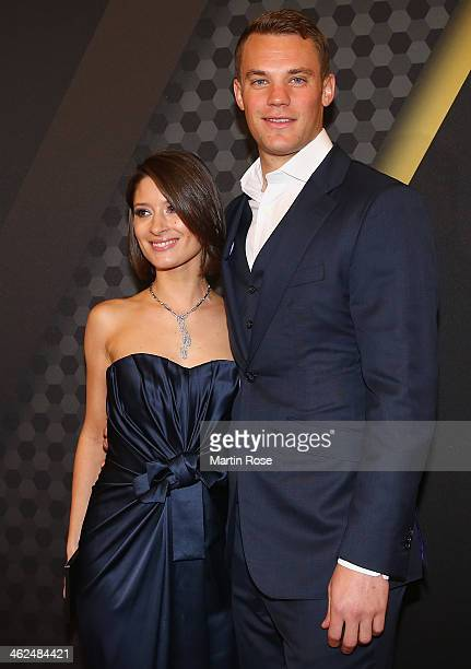 Manuel Neuer of Bayern Muenchen and girlf friend Kathrin Gilch arrive during the FIFA Ballon d'Or Gala 2013at the Kongresshalle on January 13 2014 in...