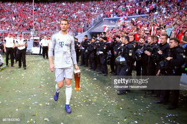 Manuel Neuer of Bayern Muenchen celebrates winning the German Championship title after the Bundesliga match between FC Bayern Muenchen and VfB...