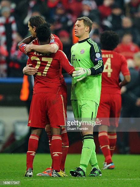 Manuel Neuer of Bayern Muenchen celebrates with David Alaba after the UEFA Champions League Round of 16 second leg match between Bayern Muenchen and...