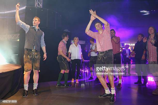 Manuel Neuer of Bayern Muenchen celebrates with his team mates Philipp Lahm and Thomas Mueller during the official Champions party Postpalast on May...