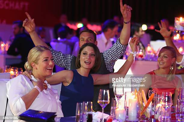 Manuel Neuer of Bayern Muenchen celebrates with Katrin Claudia Lahm and Bernadien Robben during the official Champions party Postpalast on May 10...