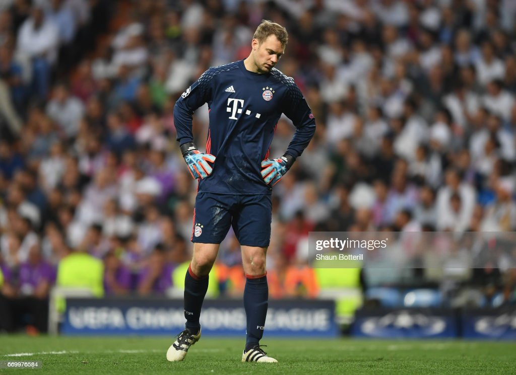 Manuel Neuer of Bayern Muenchen looks dejected during the UEFA Champions League Quarter Final second leg match between Real Madrid CF and FC Bayern Muenchen at Estadio Santiago Bernabeu on April 18, 2017 in Madrid, Spain.