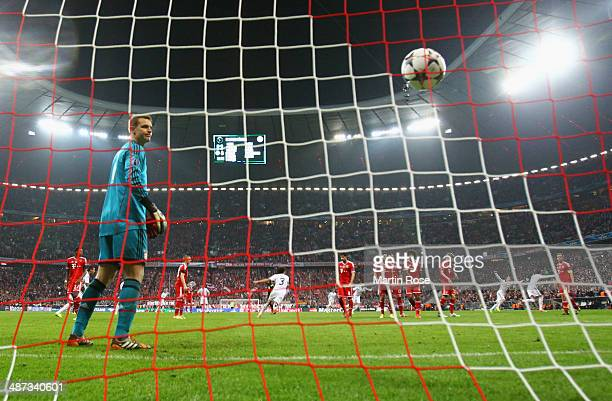 Manuel Neuer of Bayern Muenchen looks on as Cristiano Ronaldo of Real Madrid scores their fourth goal from a free kick during the UEFA Champions...