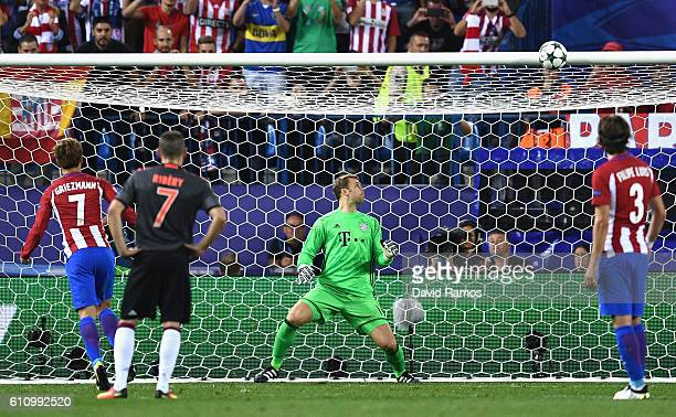 Manuel Neuer of Bayern Muenchen watches as Antoine Griezmann of Atletico Madrid misses a penalty during the UEFA Champions League group D match...
