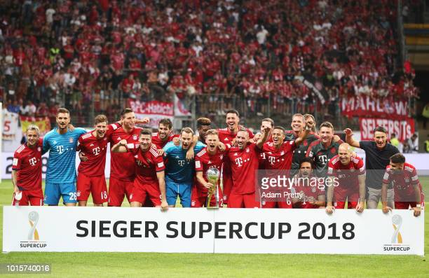 Manuel Neuer of Bayern Munich and his team mates celebrat winning the DFL Supercup 2018 match between Eintracht Frankfurt and Bayern Muenchen at...