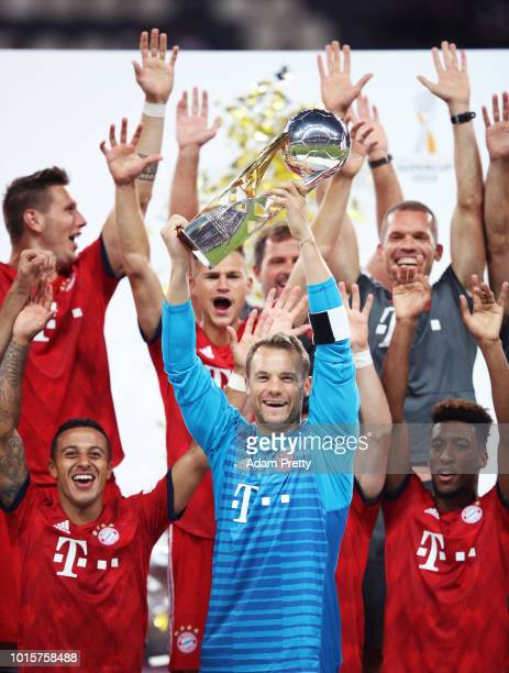 Manuel Neuer of Bayern Munich and his team mates celebrate winning the DFL Supercup 2018 match between Eintracht Frankfurt and Bayern Muenchen at...