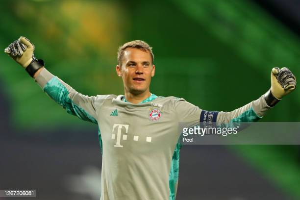 Manuel Neuer of Bayern Munich celebrates after his teammate Robert Lewandowski of Bayern Munich scored their team's third goal during the UEFA...