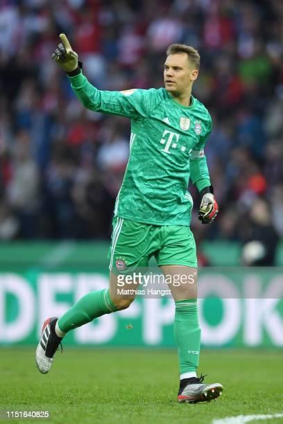 Manuel Neuer of Bayern Munich celebrates after teammate Robert Lewandowski scores their team's first goal during the DFB Cup final between RB Leipzig...