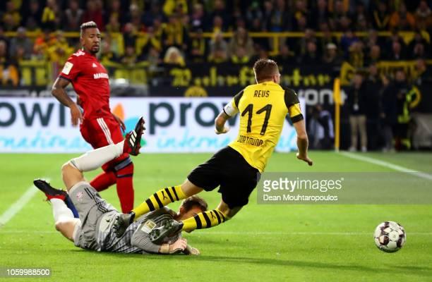 Manuel Neuer of Bayern Munich fouls Marco Reus of Borussia Dortmund inside the penalty area leading to Borussia Dortmund being awarded a penalty...