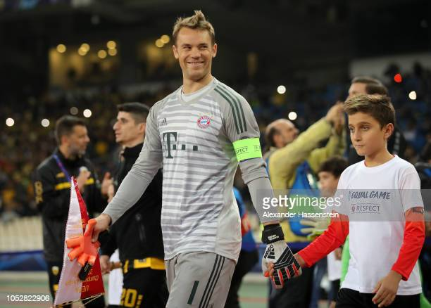 Manuel Neuer of Bayern Munich leads his team out prior to the Group E match of the UEFA Champions League between AEK Athens and FC Bayern Muenchen at...