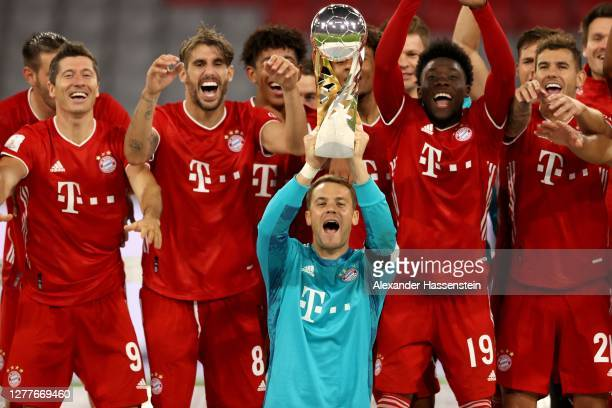 Manuel Neuer of Bayern Munich lifts the Supercup 2020 as he celebrates with his team mates after the Supercup 2020 match between FC Bayern Muenchen...