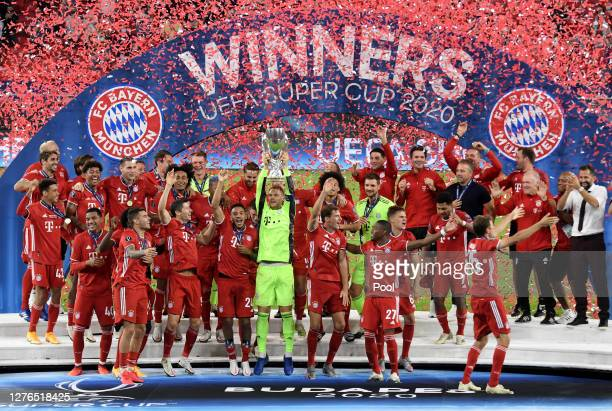 Manuel Neuer of Bayern Munich lifts the UEFA Super Cup trophy as he celebrates victory over FC Sevilla at Puskas Arena on September 24, 2020 in...