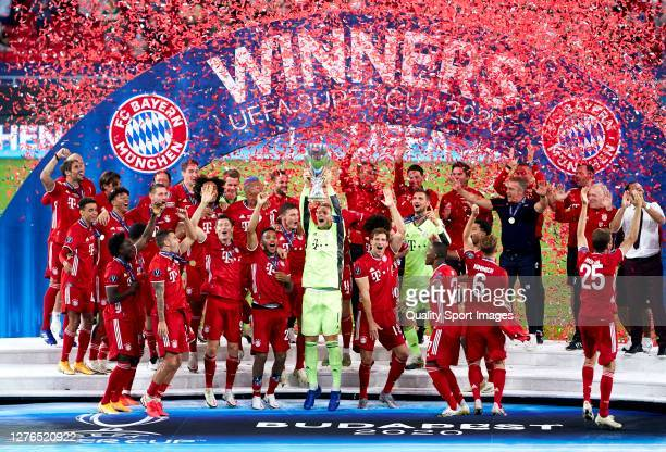 Manuel Neuer of Bayern Munich lifts the UEFA Super Cup trophy as he and team mates celebrate victory after the UEFA Super Cup match between FC Bayern...