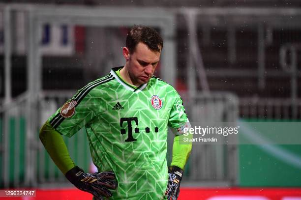 Manuel Neuer of Bayern Munich looks dejected as he reacts during the shootout during the DFB Cup second round match between Holstein Kiel and Bayern...
