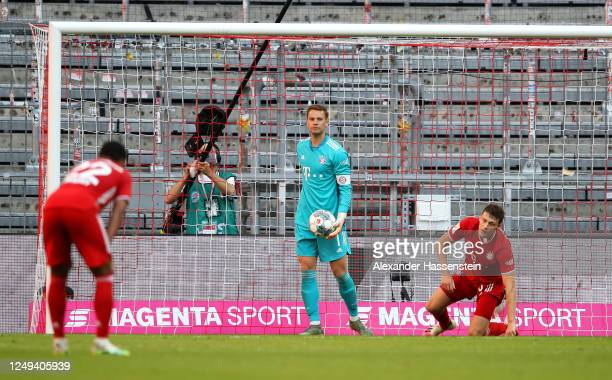 Manuel Neuer of Bayern Munich reacts to conceding a goal during the Bundesliga match between FC Bayern Muenchen and Borussia Moenchengladbach at...