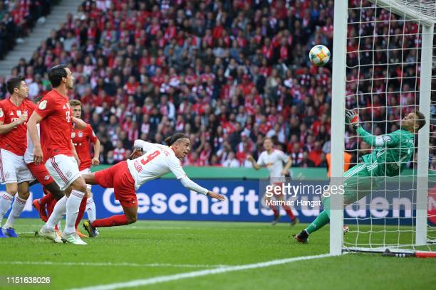 Manuel Neuer of Bayern Munich saves from Yussuf Poulsen of RB Leipzig during the DFB Cup final between RB Leipzig and Bayern Muenchen at...